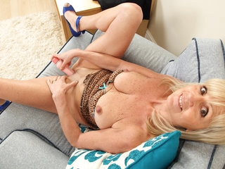 British gilf Dolly dildos her fabulous fanny